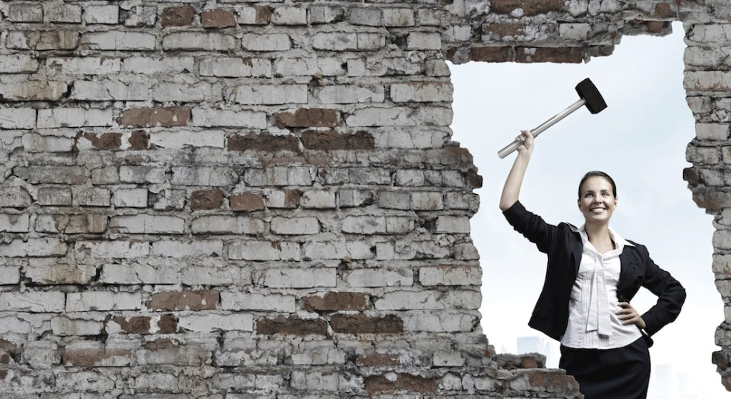 Woman breaking through wall