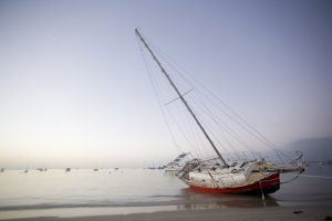 A yacht beached after a storm.