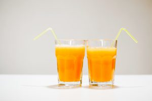 two glasses of orange juice